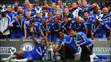 Chelsea's squad celebrate winning the Premier League