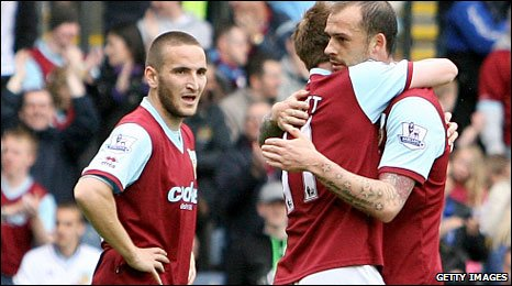 Burnley's Wade Elliott and Steven Fletcher celebrate a goal against Tottenham
