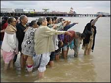 Hindu worshippers take a dip in the water at Clacton-on-Sea