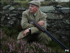 gamekeeper with rifle