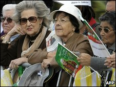 Fans wait to welcome Pope Benedict XVI to Portugal