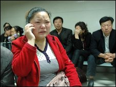 Parents of injured children wait at a hospital in Hanzhong City, Shaanxi, China (12 May 2010)