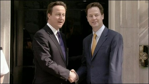 David Cameron and Nick Clegg shake hands on the steps of Number 10 Downing Street