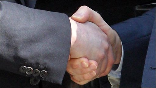 David Cameron and Nick Clegg shake hands outside Number Ten