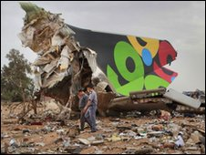 Rescue teams search the site of the Libyan Afriqiyah Airways plane crash in Tripoli,
