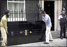 Workmen remove the door to give it a fresh lick of paint, 2002