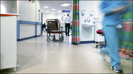 An empty wheelchair in a hospital ward