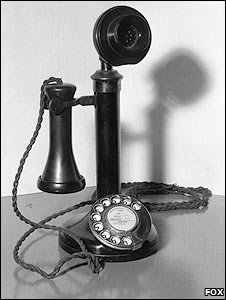 A candlestick telephone