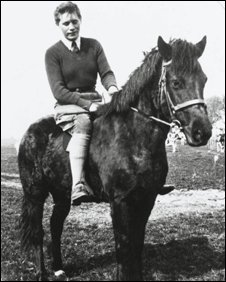 Mona McLeod  in WLA uniform on horse in 1942