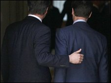 David Cameron and Nick Clegg entering Downing St