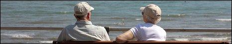 Pensioners by seaside