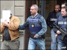A man escorted by police in Piacenza, 12 May (Carabinieri of Piacenza)