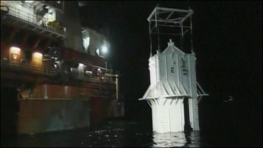 Steel dome being lowered into waters of Gulf of Mexico