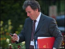 Oliver Letwin using his mobile phone