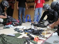 Police set out evidence seized in a raid in Solo, Java, on 13 May 2010