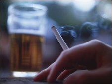 Close up of a pint and a cigarette