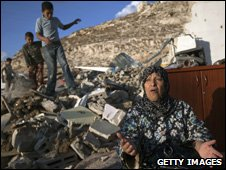 A woman outside her demolished house in East Jerusalem (File picture November 2009)