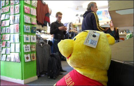 Tagged teddy bear in Oxfam shop