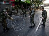 Thai soldiers string razor wire across Bangkok road near red-shirt protest camp - 14 May 2010