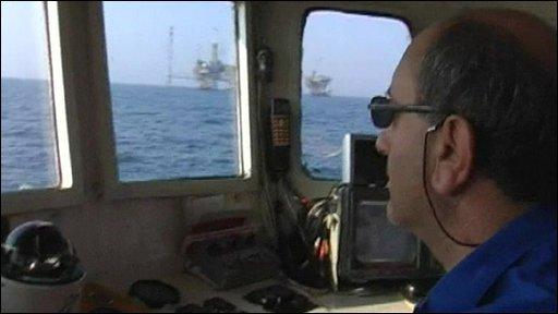 Greek boat patrolling near oil rig in Aegean Sea