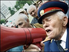 Retired army colonel with megaphone