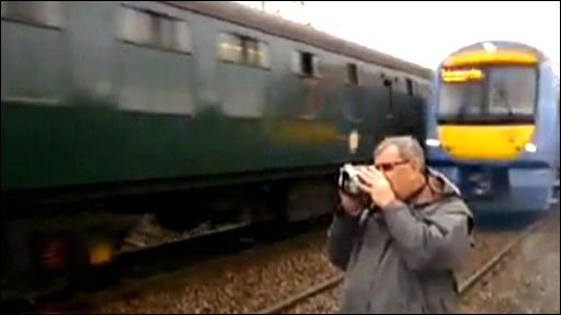 Train spotter filming as train approaches
