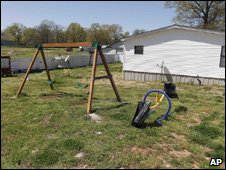 A swing set is seen in the backyard of Torry Hansen and Nancy Hansen's shared backyard in Shelbyville, Tenn