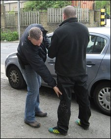 Fan being searched by arresting officer