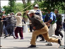 People fight during a rally in the Kyrgyz city of Jalalabad (14 May)
