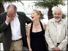 Director Mike Leigh  R) poses with cast members Jim Broadbent and Lesley Manville
