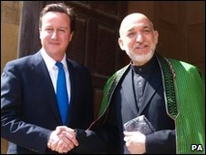Prime Minister David Cameron greets Afganistan's President Hamid Karzai on the steps of the PM's country residence of Chequers, Buckinghamshire