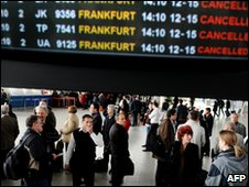 People stand in front of an information board in the departure hall of Sofia airport (April 2010)