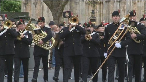 A military band leads the parade