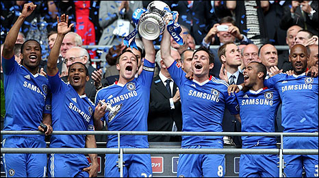 Chelsea lift the FA Cup trophy after beating Portsmouth