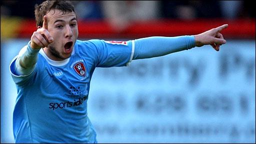 Rotherham's Adam le Fondre celebrates scoring