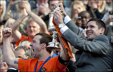 Lee Wilkie lifts the Scottish Cup with Andy Webster