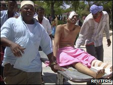 A wounded civilian in Mogadishu on 16 May 2010