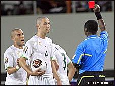 Algeria's Nadir Belhadj receives red card