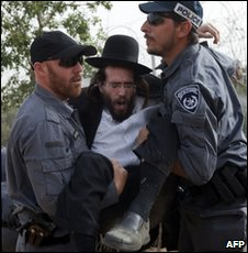 Israeli police detain an ultra-Orthodox Jewish protester in Ashkelon on 16 May 2010