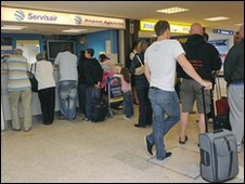 Passengers queue for information at Leeds Bradford Airport