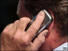 Mobile phone user in London - file image