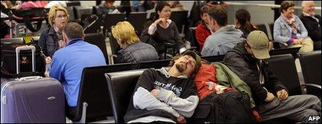 Passengers wait for planes