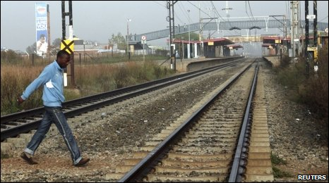 Man walks across railway