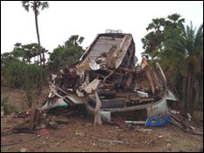 The wreckage of a passenger bus is pictured after a landmine explosion near Dantewada in Chhattisgarh 17/05/2010 Reuters
