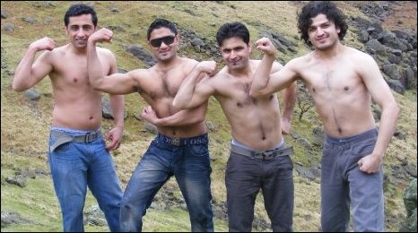 Pakistani Students posing and flexing muscles outdoors