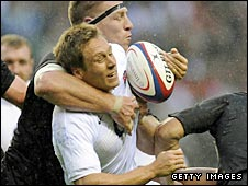 England fly-half Jonny Wilkinson is tackled by New Zealand second row Brad Thorn