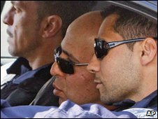 Ali Vakili Rad, centre, leaves prison near Paris, 18 May 2010