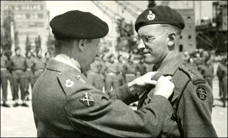 Captain Peter Neale being presented with his military cross by Field Marshal Montgomery