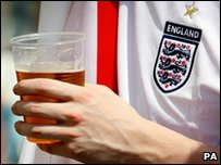 An England fan enjoys a drink