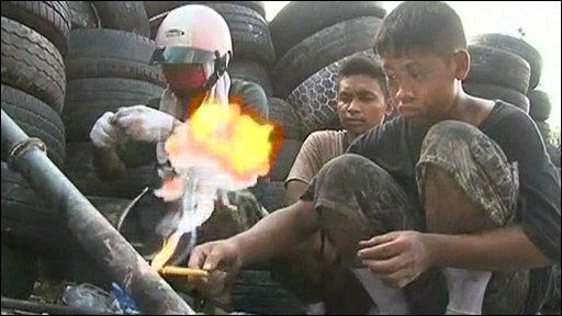 Thai teenager lighting homemade missile launcher